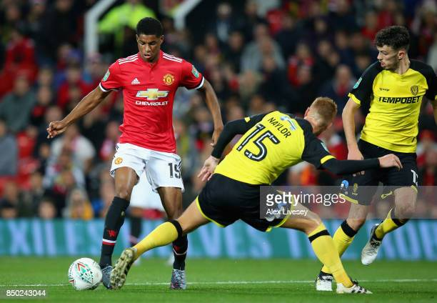 Marcus Rashford of Manchester United attempts to get past Tom Naylor of Burton Albion during the Carabao Cup Third Round match between Manchester...
