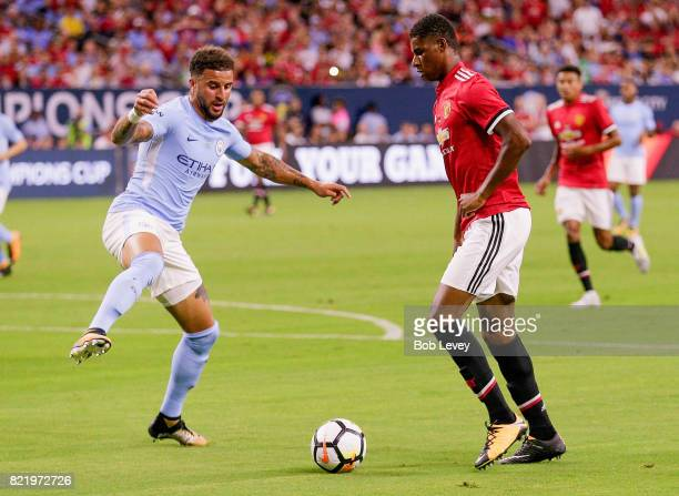 Marcus Rashford of Manchester United attempts to shoot around Kyle Walker of Manchester City at NRG Stadium on July 20 2017 in Houston Texas