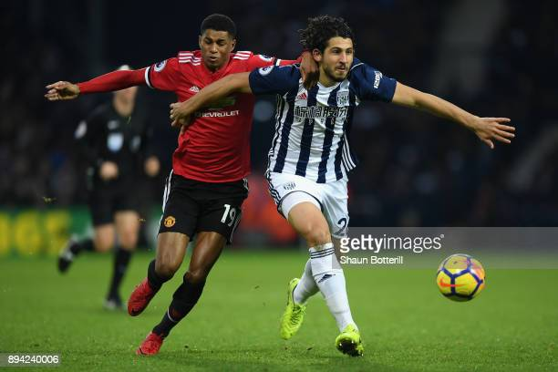 Marcus Rashford of Manchester United battles for possesion with Ahmed ElSayed Hegazi of West Bromwich Albion during the Premier League match between...