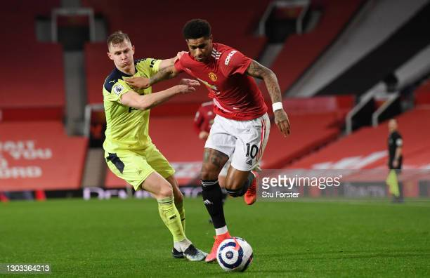 Marcus Rashford of Manchester United battles for possession with Emil Krafth of Newcastle United during the Premier League match between Manchester...