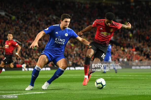 Marcus Rashford of Manchester United battles for possession with Harry Maguire of Leicester City during the Premier League match between Manchester...