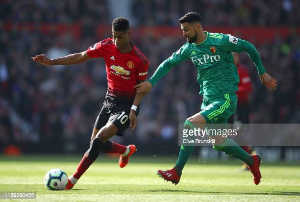 Marcus Rashford of Manchester United battles for possession with Miguel Britos of Watford during the Premier League match between Manchester United...