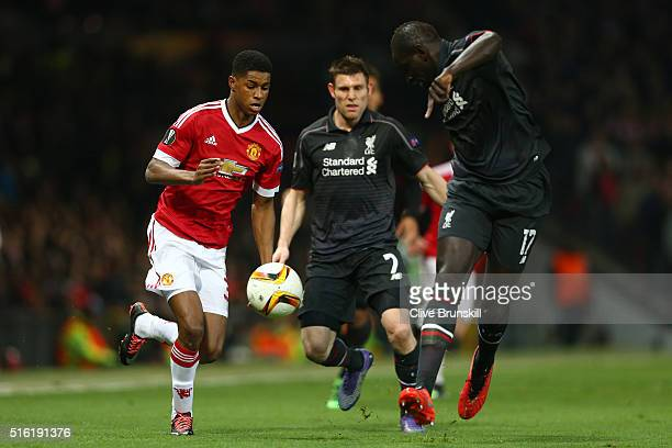 Marcus Rashford of Manchester United battles with James Milner and Mamadou Sakho of Liverpool during the UEFA Europa League round of 16 second leg...