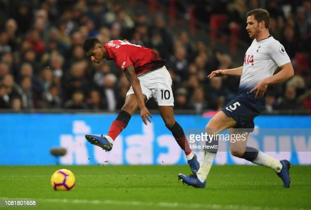 Marcus Rashford of Manchester United beats Jan Vertonghen of Tottenham Hotspur as he scores his team's first goal during the Premier League match...