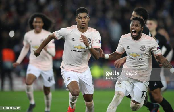 Marcus Rashford of Manchester United celebrates after he scores the third goal during the UEFA Champions League Round of 16 Second Leg match between...