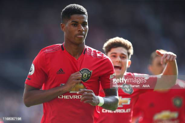 Marcus Rashford of Manchester United celebrates after scoring a goal to make it 10 during the Premier League match between Manchester United and...