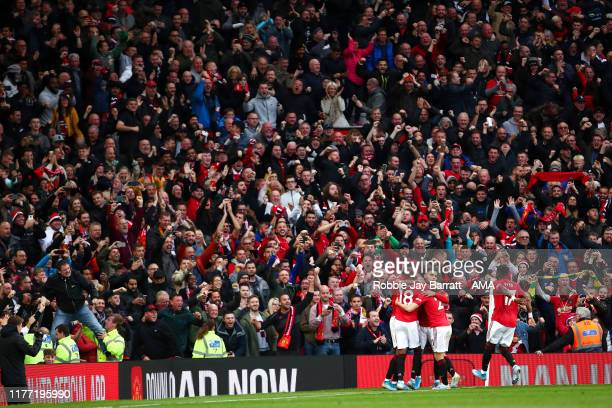 Marcus Rashford of Manchester United celebrates after scoring a goal to make it 1-0 during the Premier League match between Manchester United and...