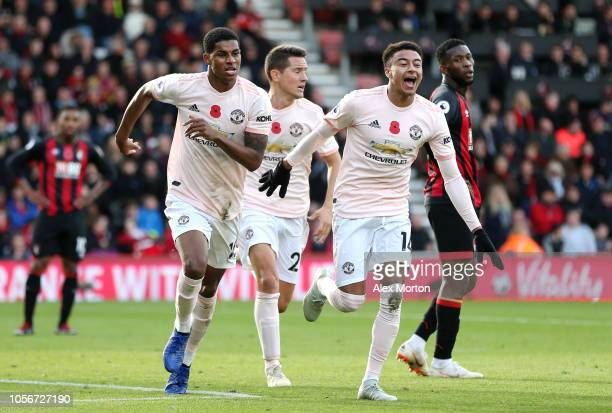 Marcus Rashford of Manchester United celebrates after scoring his team's second goal with Ander Herrera of Manchester United and Jesse Lingard of...