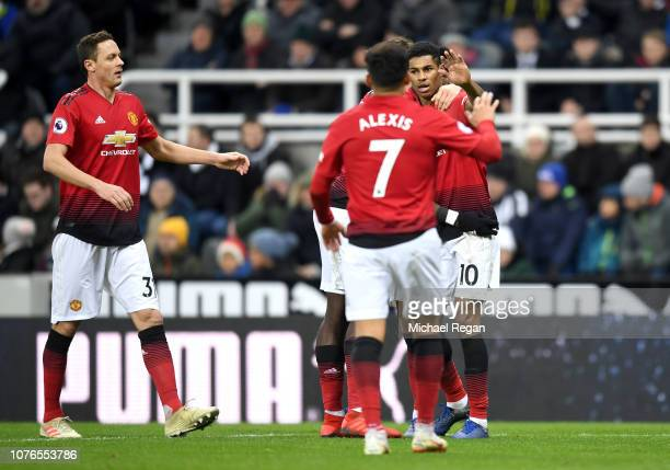 Marcus Rashford of Manchester United celebrates after scoring his team's second goal with his team mates during the Premier League match between...