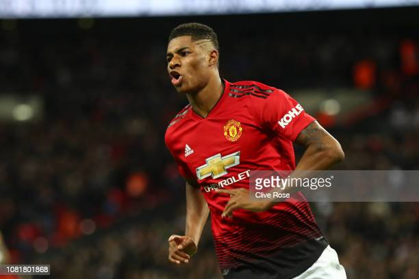 Marcus Rashford of Manchester United celebrates after scoring his team's first goal during the Premier League match between Tottenham Hotspur and...