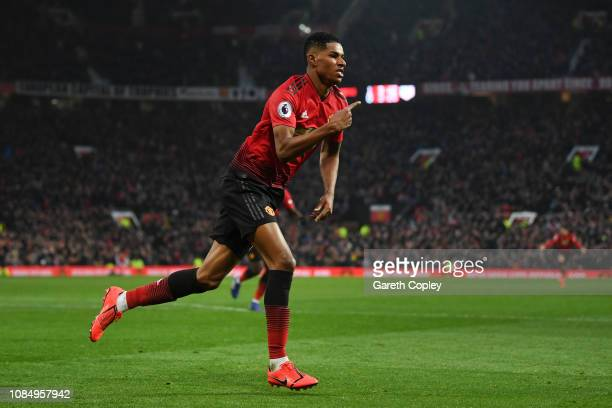 Marcus Rashford of Manchester United celebrates after scoring his sides second goal during the Premier League match between Manchester United and...