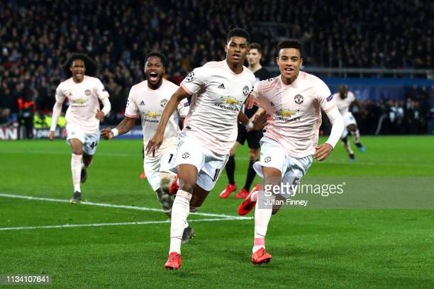 Marcus Rashford of Manchester United celebrates after scoring his sides third goal with teammates during the UEFA Champions League Round of 16 Second...