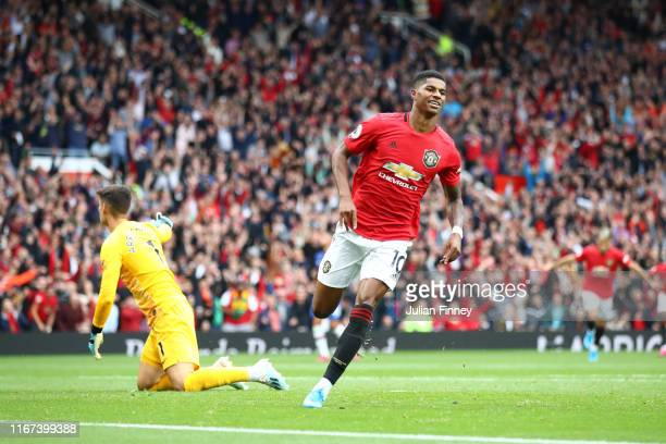 Marcus Rashford of Manchester United celebrates after scoring his team's third goal during the Premier League match between Manchester United and...