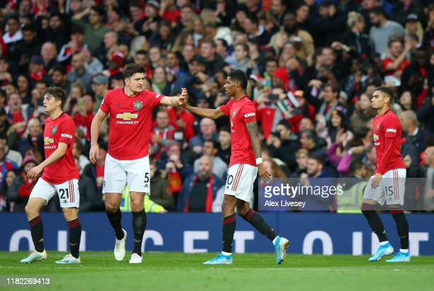 Marcus Rashford of Manchester United celebrates after scoring his sides first goal with Harry Maguire of Manchester United during the Premier League...