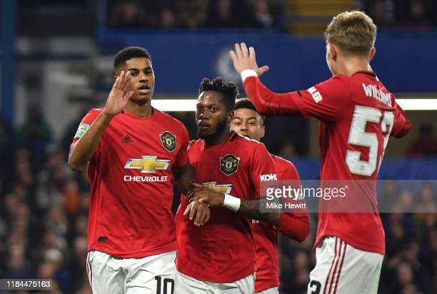Marcus Rashford of Manchester United celebrates after scoring his team's first goal with Brandon Williams and Fred of Manchester United during the...