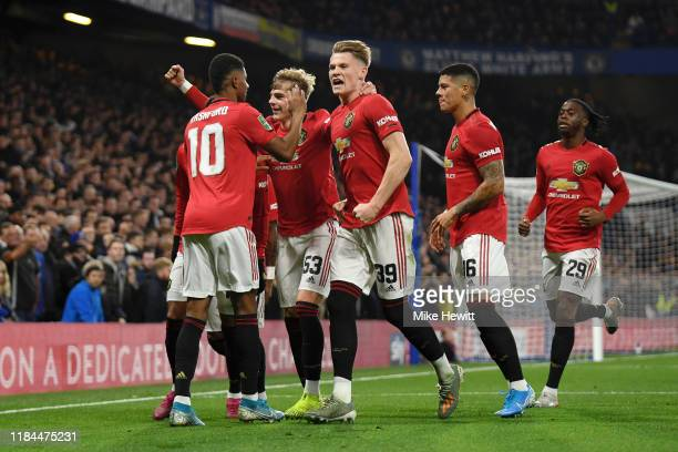 Marcus Rashford of Manchester United celebrates after scoring his team's first goal with his team mates during the Carabao Cup Round of 16 match...
