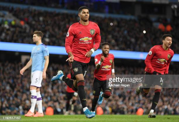 Marcus Rashford of Manchester United celebrates after scoring his team's first goal during the Premier League match between Manchester City and...