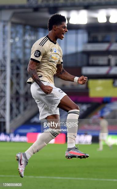 Marcus Rashford of Manchester United celebrates after scoring his sides first goal during the Premier League match between Crystal Palace and...