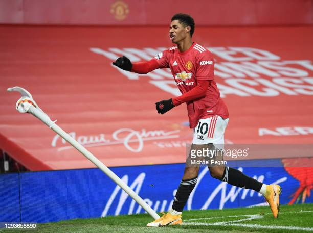 Marcus Rashford of Manchester United celebrates after scoring his team's first goal during the Premier League match between Manchester United and...