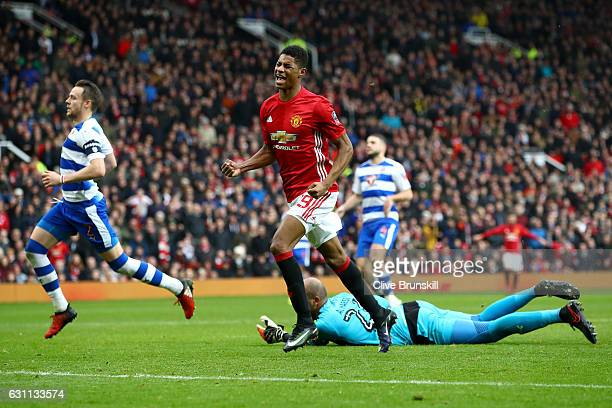 Marcus Rashford of Manchester United celebrates after scoring his sides third goal during the Emirates FA Cup third round match between Manchester...