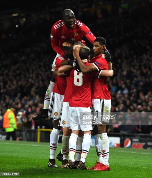 Marcus Rashford of Manchester United celebrates after scoring his sides second goal with his Manchester United team mates during the UEFA Champions...