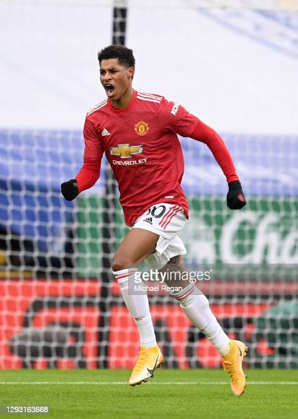 Marcus Rashford of Manchester United celebrates after scoring their team's first goal during the Premier League match between Leicester City and...