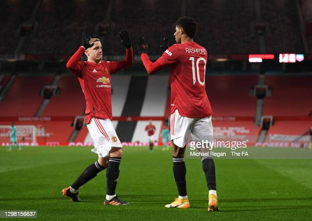 Marcus Rashford of Manchester United celebrates after scoring their sides second goal with team mate Donny van de Beek during The Emirates FA Cup...