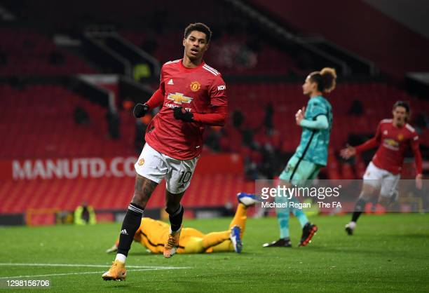 Marcus Rashford of Manchester United celebrates after scoring their side's second goal during The Emirates FA Cup Fourth Round match between...
