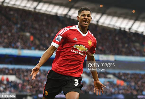 Marcus Rashford of Manchester United celebrates as he scores their first goal during the Barclays Premier League match between Manchester City and...