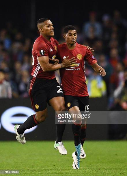 Marcus Rashford of Manchester United celebrates as he scores their first goal with Antonio Valencia during the UEFA Europa League semi final first...