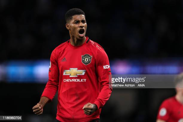 Marcus Rashford of Manchester United celebrates at full time during the Premier League match between Manchester City and Manchester United at Etihad...