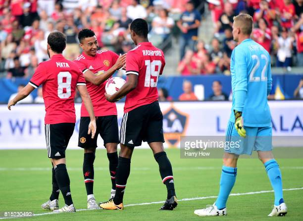 Marcus Rashford of Manchester United celebrates his goal with Jesse Lingard and Juan Mata in front of Jon Kempin of Los Angeles Galaxy to take a 10...
