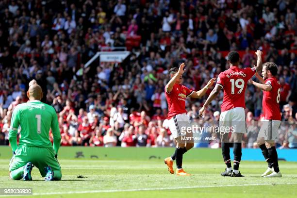 Marcus Rashford of Manchester United celebrates his goal with Juan Mata of Manchester United and Alexis Sanchez of Manchester United during the...