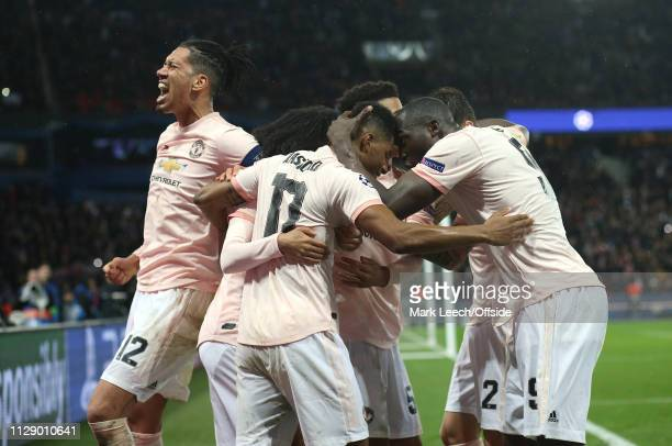 Marcus Rashford of Manchester United celebrates his goal with Romelu Lukaku as Chris Smalling shouts with joy during the UEFA Champions League Round...