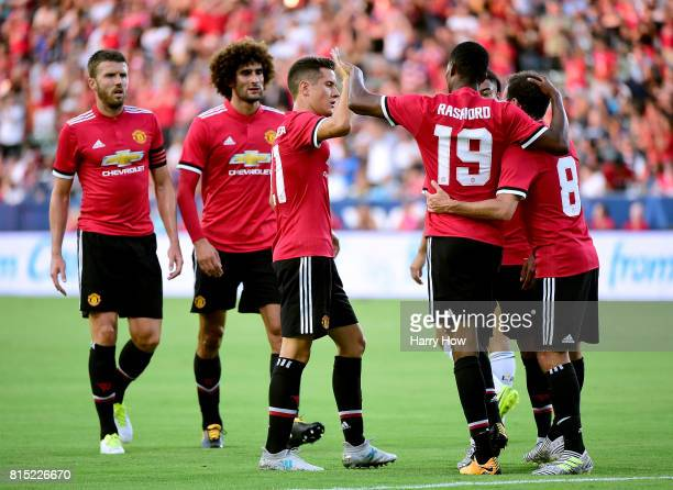 Marcus Rashford of Manchester United celebrates his second goal of the first half with Juan Mata and Ander Herrera to take a 20 lead over the Los...