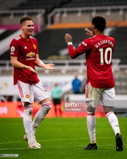 Marcus Rashford of Manchester United celebrates scoring a goal to make the score 14 with Scott McTominay during the Premier League match between...