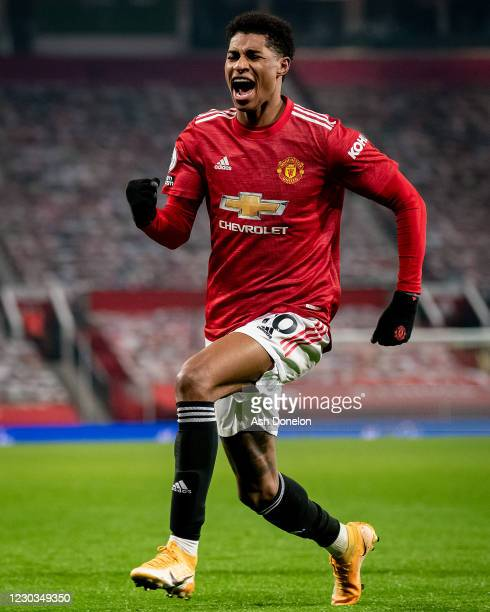 Marcus Rashford of Manchester United celebrates scoring a goal to make the score 1-0 during the Premier League match between Manchester United and...