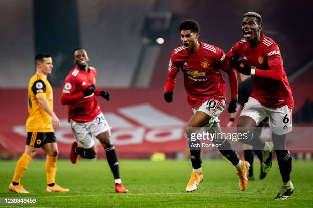 Marcus Rashford of Manchester United celebrates scoring a goal to make the score 1-0 with Paul Pogba during the Premier League match between...