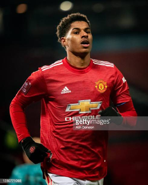 Marcus Rashford of Manchester United celebrates scoring a goal to make the score 2-1 during the Emirates FA Cup Fourth Round match between Manchester...