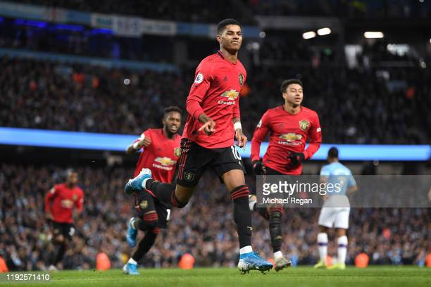 Marcus Rashford of Manchester United celebrates scoring a penalty to make it 1-0 during the Premier League match between Manchester City and...