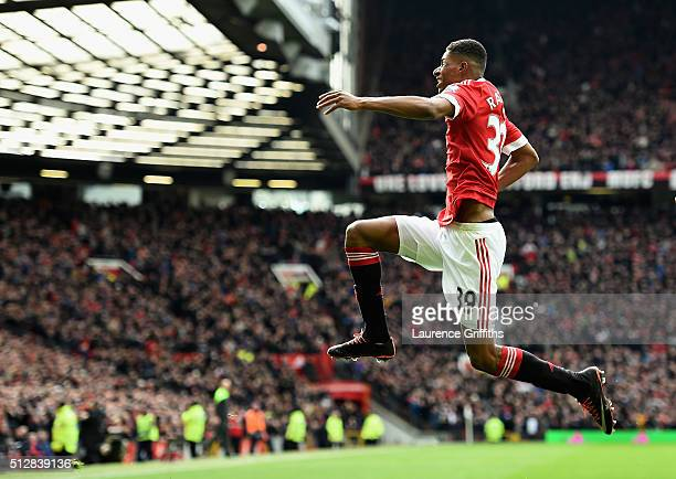 Marcus Rashford of Manchester United celebrates scoring his opening goal during the Barclays Premier League match between Manchester United and...