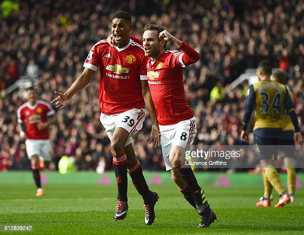 Marcus Rashford of Manchester United celebrates scoring his opening goal with Juan Mata during the Barclays Premier League match between Manchester...