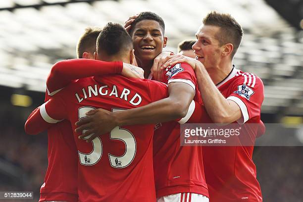 Marcus Rashford of Manchester United celebrates scoring his second goal with team mates during the Barclays Premier League match between Manchester...
