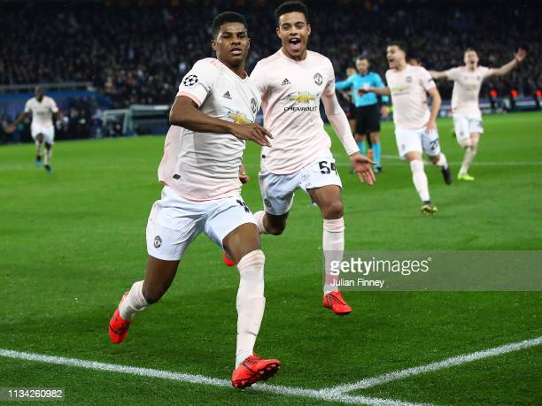 Marcus Rashford of Manchester United celebrates scoring his sides third goal from the penalty spot during the UEFA Champions League Round of 16...