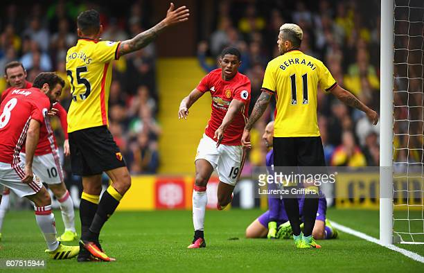Marcus Rashford of Manchester United celebrates scoring his sides first goal during the Premier League match between Watford and Manchester United at...