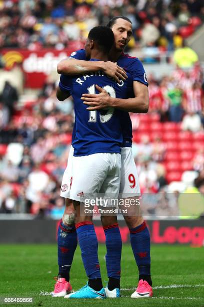 Marcus Rashford of Manchester United celebrates scoring his side's third goal with teammate Zlatan Ibrahimovic during the Premier League match...
