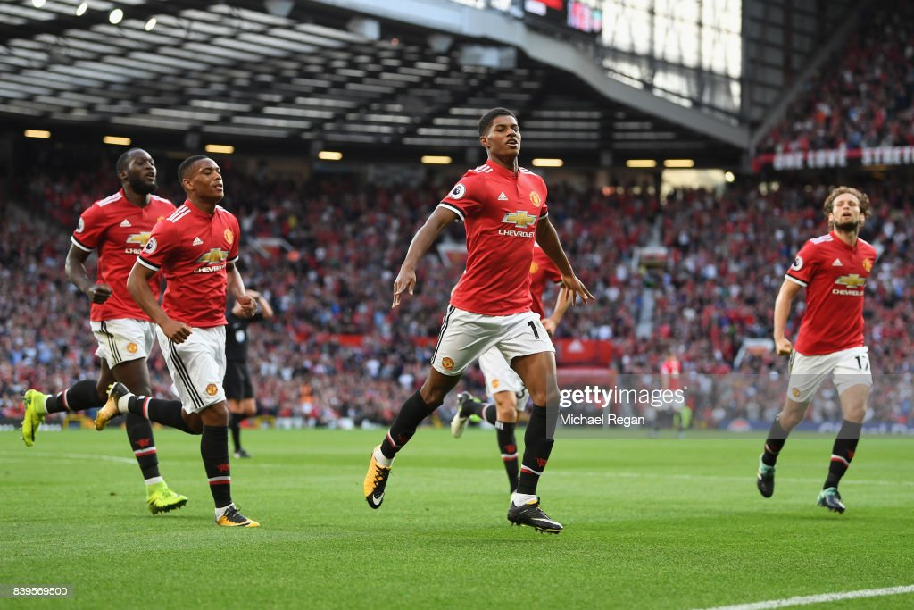 Marcus Rashford of Manchester United celebrates scoring his sides first goal with his Manchester United team mates during the Premier League match between Manchester United and Leicester City at Old Trafford on August 26, 2017 in Manchester, England.