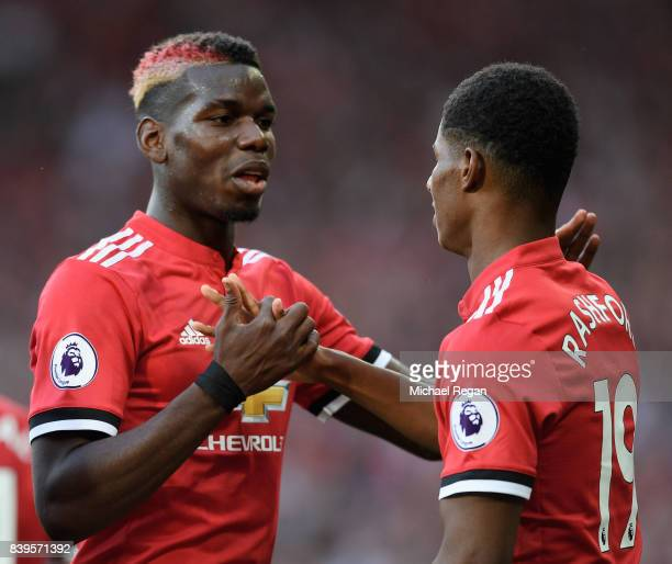 Marcus Rashford of Manchester United celebrates scoring his sides first goal with Paul Pogba of Manchester United during the Premier League match...