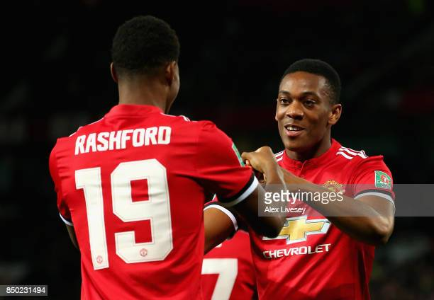 Marcus Rashford of Manchester United celebrates scoring his sides first goal with Henrikh Mkhitaryan of Manchester United during the Carabao Cup...