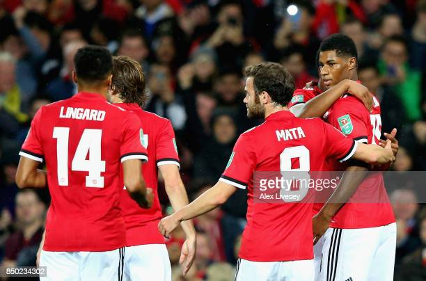 Marcus Rashford of Manchester United celebrates scoring his sides second goal with his Manchester United team mates during the Carabao Cup Third...